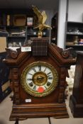 A wood framed mantel clock by Asonia Clock Co, New York with enamel face