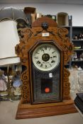 An Ansonia Clock Co, America 8 day gingerbreaad clock