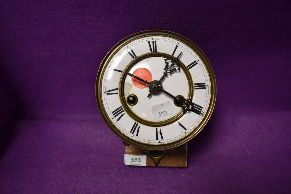An enamel faced clock movement