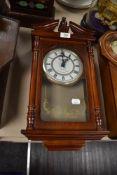 An Emperor Quartz wall clock