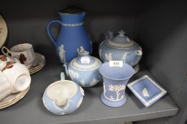 A selection of light blue ground Jasperware pottery by Wedgwood including tea pot with stand sugar
