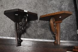 two oak wall sconce or shelf bracket having naturalistic carved support one oak and one dark