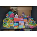 A shelf of Bluebird Polly Pocket accessories and figures along with similar Polly Pocket and Pound