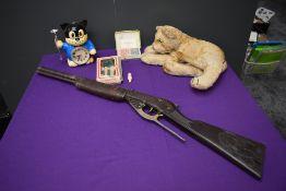 A Steiff style Lion Cub Soft Toy, a Lone Star style Wild West Toy Rifle, a 1980's Quartz Citizen