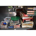 A shelf of mixed vintage Toys and Games including 1970's Lego pieces in plastic boxes, Action GT