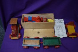 A NicolToys wooden Multi Builder part set MB1, with instructions and in original box along with a