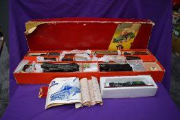 A TTR Trix Twin Railway Goods Train Set No 2/324 comprising, LMS 0-4-0 Loco & Tender, seven