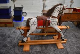 A modern Rocking Horse having name plate for Clive Taylor 1997, dapple grey with horse hair mane and