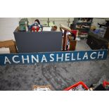 A mid 20th century wooden Railway Station Sign for Achnashellach in blue with white lettering,