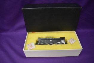 A Hallmark Models Inc made by Samhongsa HO scale AT & SF Baldwin Switcher Locomotive 2229 in