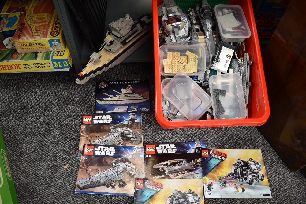 A large box containing 13kg of mixed vintage Lego including instruction booklets numbered Movie