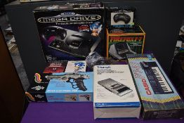 A Sega Mega Drive 16-Bit Console with two controllers and two games Maximum Carnage and Sonic the