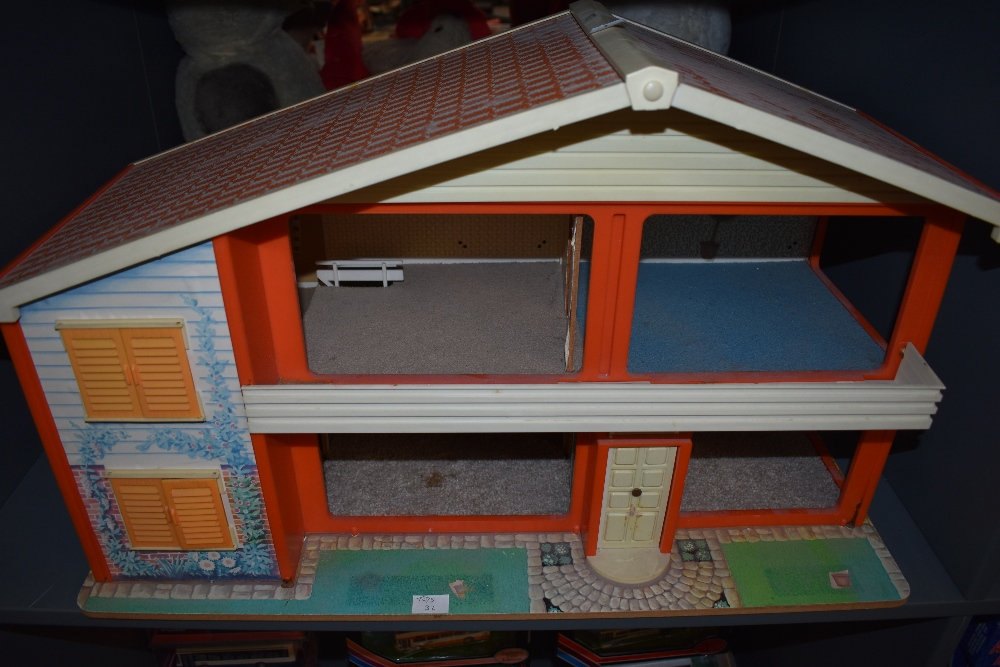 A 1970's wooden and plastic two story My First Home Doll's House