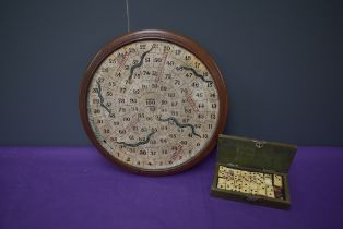 A Victorian circular wooden Snakes & Ladders Board made by F H Ayres London having red ladders and