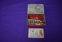 A Schuco Telesteering Car 3000 in red with accessories and instructions present, in original box