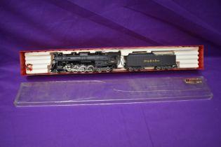 A Rivarossi HO scale 2-8-4 NYC & STL Nickel Plate Road Loco & Tender 779, in original display box