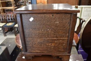 A small oak storage box fabric lined for haberdashery or similar use with open top lid