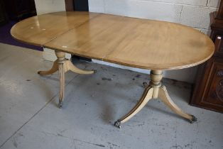 A nice quality reproduction Regency bleached mahogany two part extendable dining table having