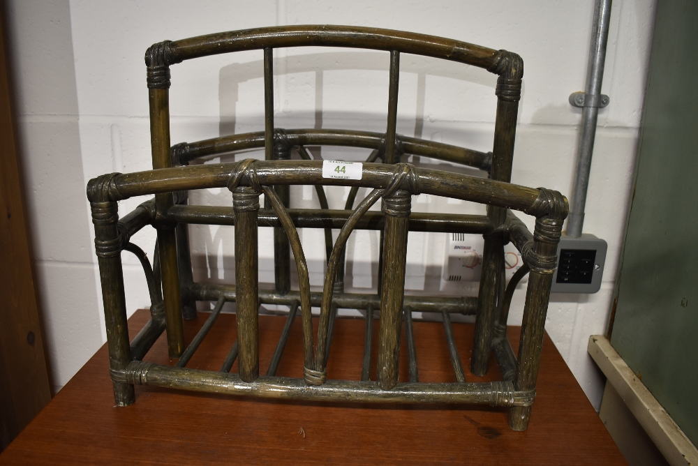 A bamboo framed magazine or similar storage rack