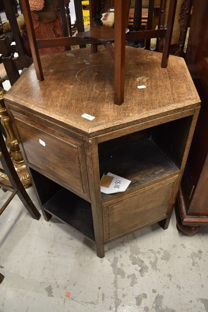 A Victorian mahogany washstand with typical holes to top for wash bowl and beakers and undershelf