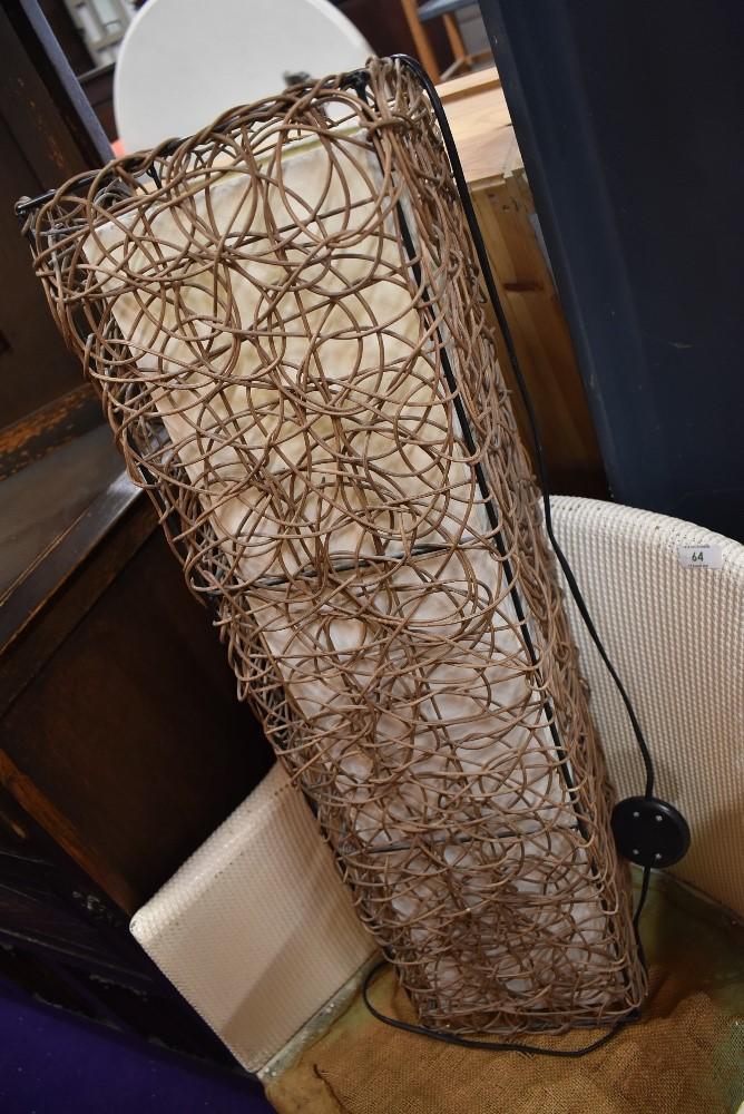 A wicker work floor lamp