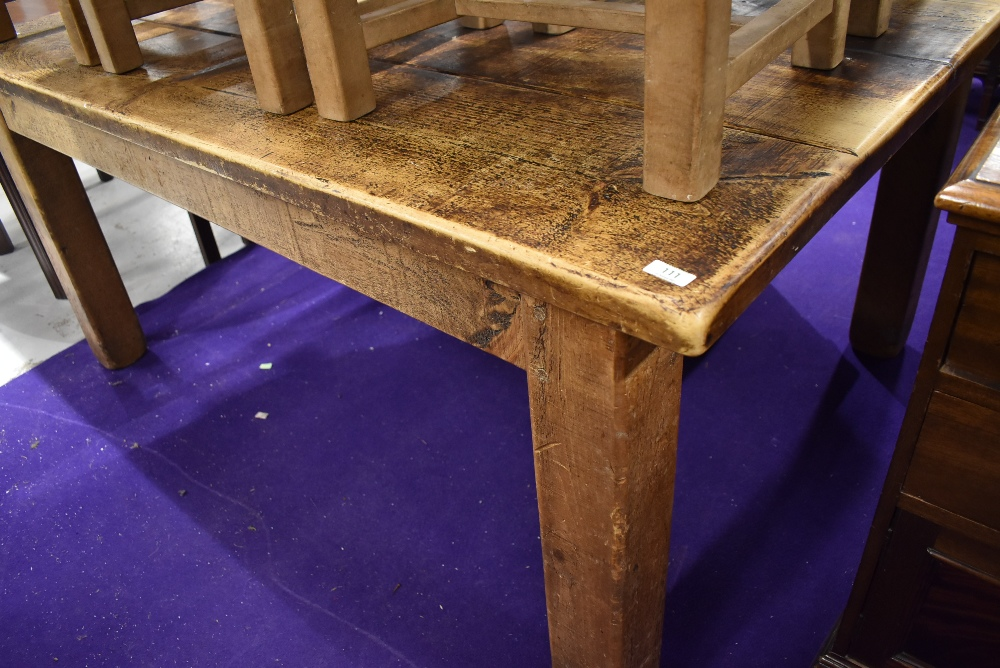A large rustic kitchen table having grooved (simulated plank) top, on chunky square legs , approx.