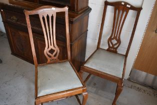 A pair of mahogany carved back dining chairs having cabriole legs