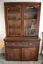 A Victorian secretaire book case having mahogany frame work with rolled glass front and decorative