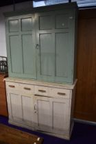 A late 19th or early 20th Century pantry or utility cupboard with dresser base in painted pine 140cm