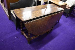 A Period oak gateleg dining table having bobbin turned style frame