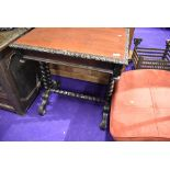 A Victorian side or games table having barley twist frame work oak carved top and inner drawer