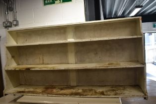 An early 20th century utility or storage shelf in painted pine ideal for stripping 6ft long