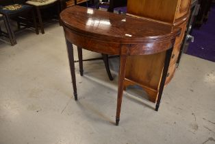 A 19th Century fold out demilune console/tea table having tapered legs with flame mahogany veneer