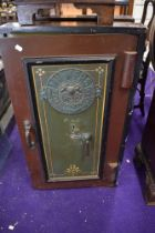 A cast iron safe by Milner's Thief Resisting and Strong Hold Fast Safe Key included
