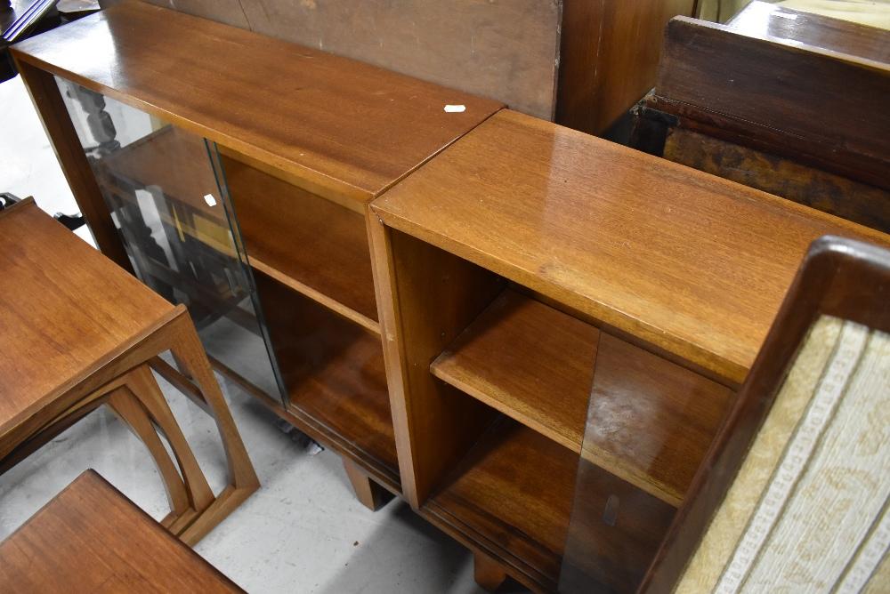 A pair of vintage glazed door bookcases, in the Herbert Ellis style