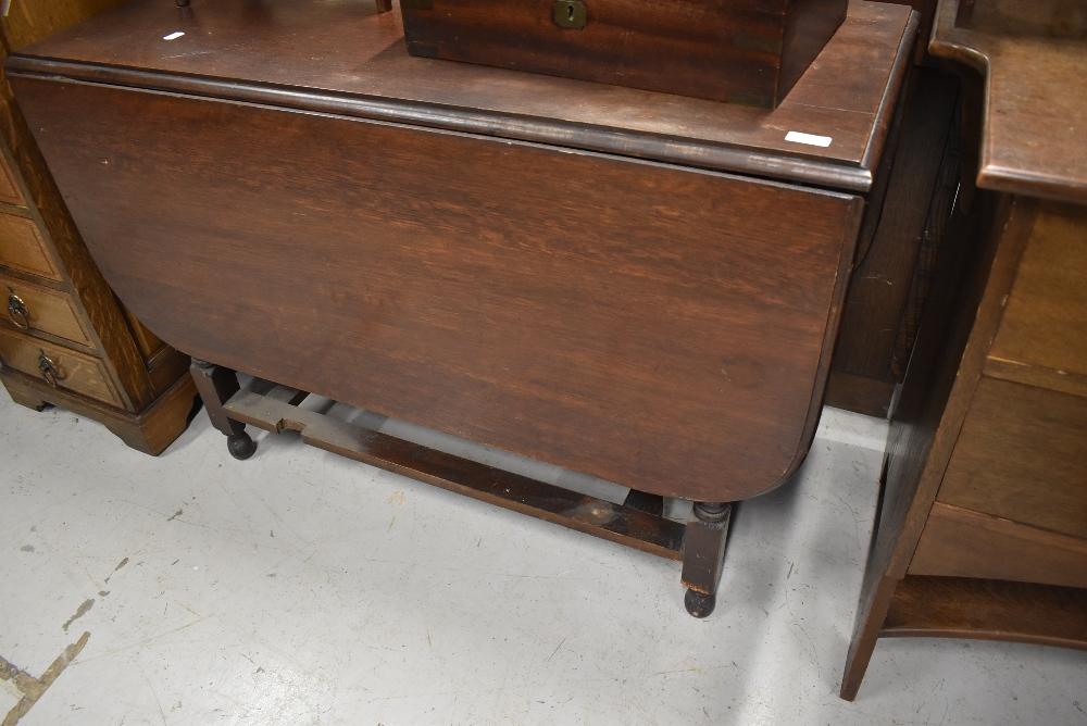 An early 20th Century oak gateleg table, width approx. 96cm