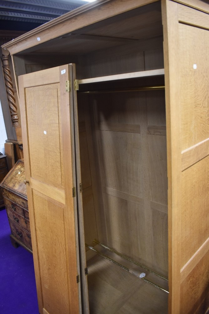 A craftsman made golden oak wardrobe, attributed to Peter Hall of Staveley, width approx. 122cm