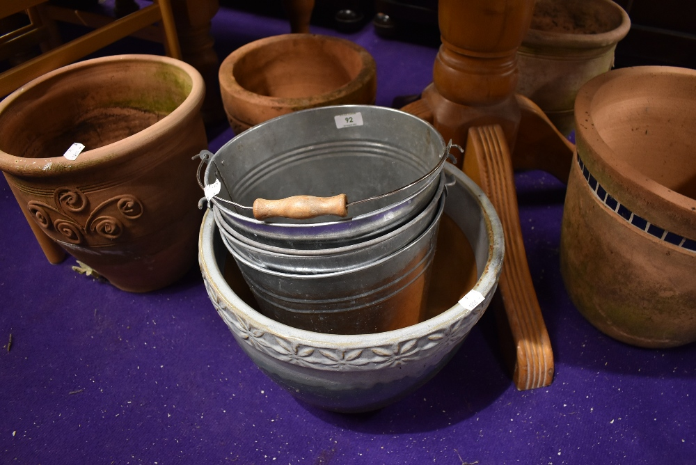 A selection of plant pots and zinc buckets