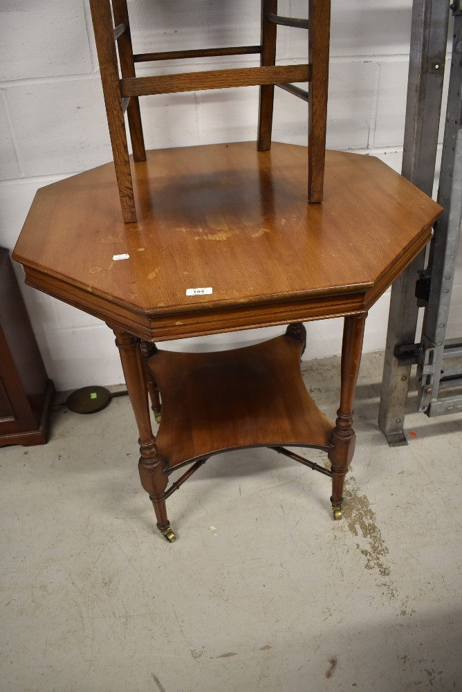 A late Victorian mahogany octagonal occasional table having undertier, on turned legs and cross