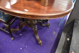 A Victorian loo table having turned and carved pedestal base on scroll legs