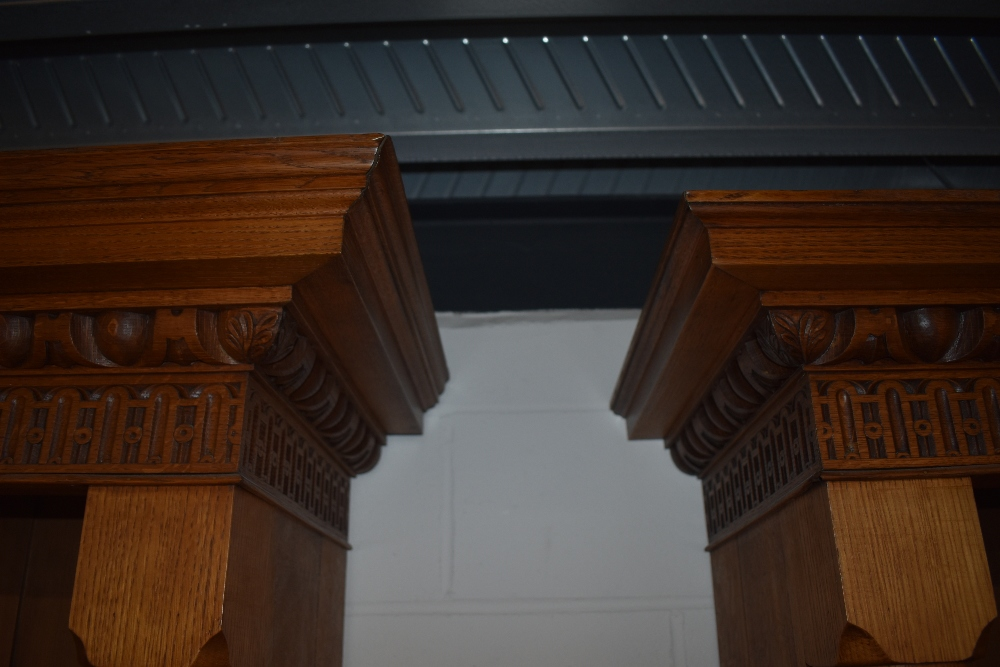 A near pair of 19th Century and later golden oak bookcases, having Corinthian column to base and - Image 3 of 4