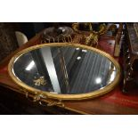 A regency style mantle mirror having gilt and gesso frame