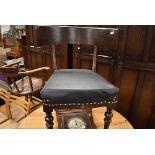 A part 19th Century dark oak framed chair having oversized rail back, later repair/reinforcements