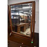 A 19th Century toilet mirror having mahogany frame, height approx. 69cm