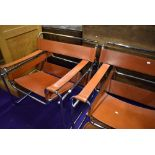 A pair of mid century design armchairs in tubular chrome and leather, probably P E L - Practical