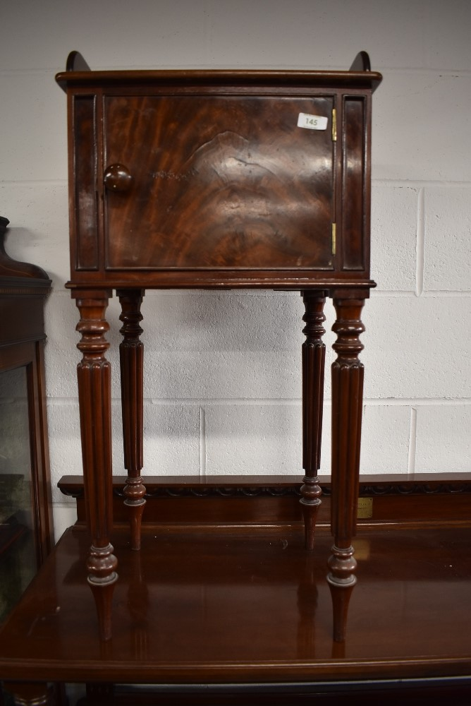 A 19th Century part flame mahogany bedside pot cupboard on fluted legs