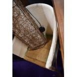 A woven fibre tub chair