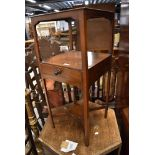 An early to mid 20t Century oak low bookcase of hexagonal form with alternate panels
