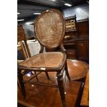 A Victorian bedroom or salon chair having balloon back and woven fibre seat