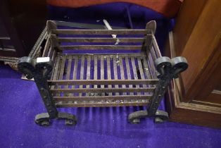 A cast iron ingle nook open fire grate 49cm wide by 34cm deep